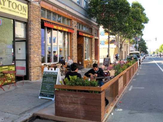 Living Innovation Zones are an evolution of the many parklets (shown here along Valencia) that have popped up all over the city and have transformed parking spaces to meeting places.